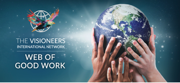 Visioneers International Network Web of Good Work with a globe supported by a collection of diverse hands symbolizing global support, collaboration and unity on a backdrop of stars.